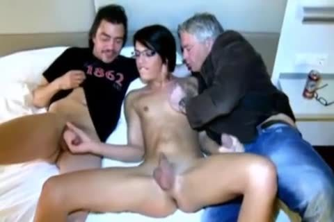 Two males With Beauty Ts brunette