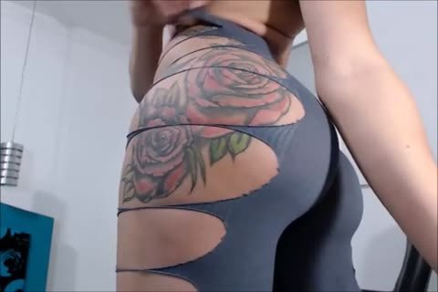 Tattooed shemale Showing Her ass
