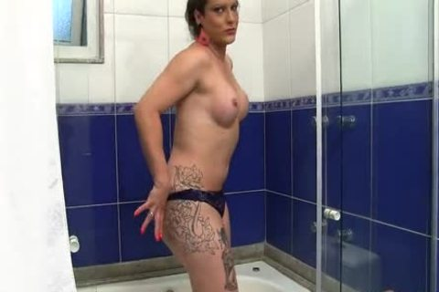 ladyman Trying To Make A dildo Fit In The Shower
