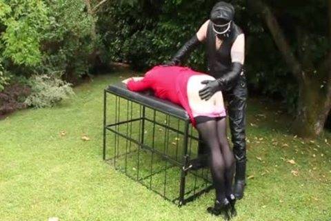 Leather Clad master spanking Whipping tgirl wazoo In Garden