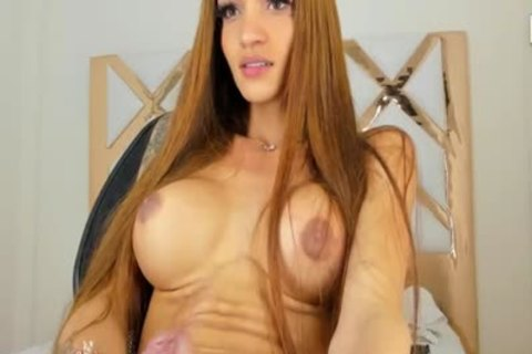skinny Colombian ladyboy With large pantoons Strokes Her large penis