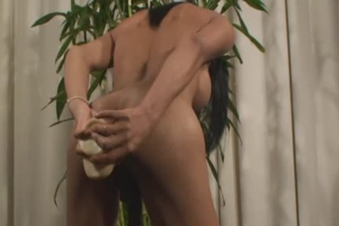 Thai Ladyboy Jessy toys Her butthole And Squeezes Out A Load